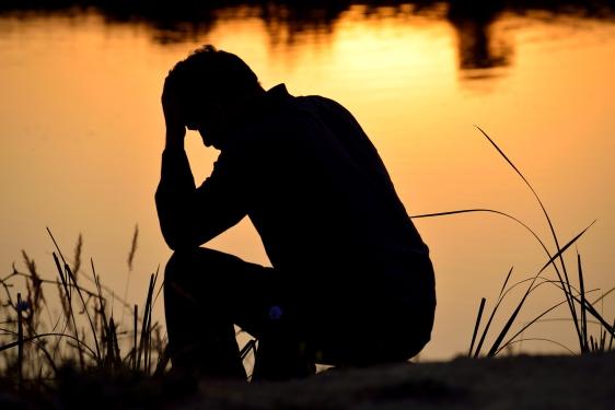 depressed-man-at-the-lake